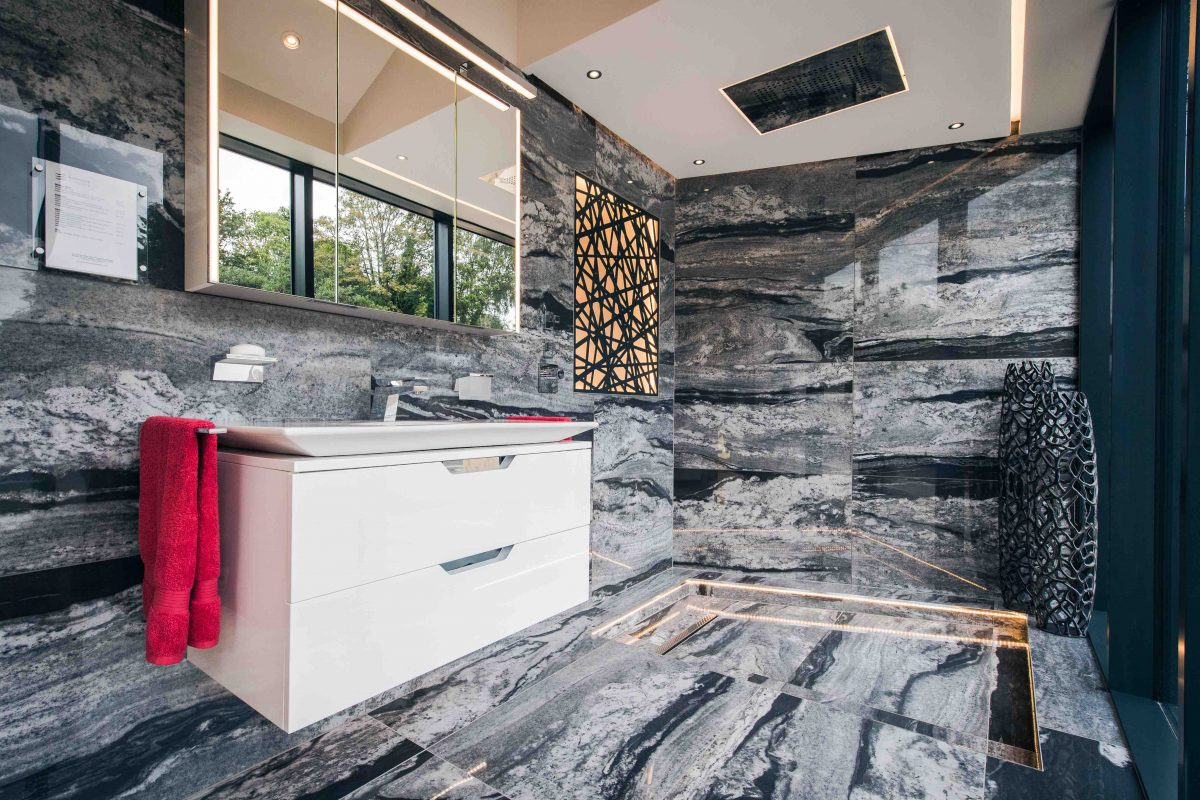 Black Marble wall and floor bathroom with long sink unit and wall mounted mirror