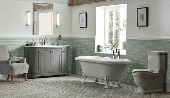 Laura Ashley Bathrooms, green ceramic tiles, toilet, free standing bath and sink unit